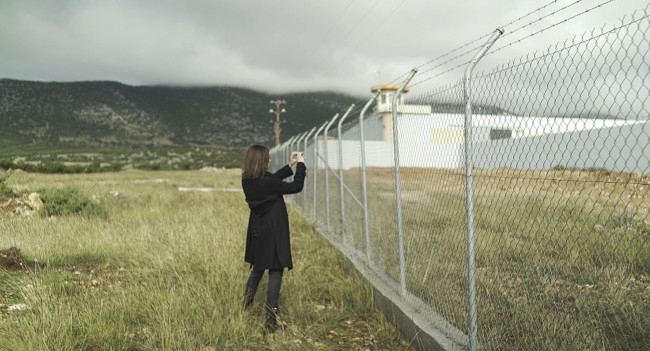 The journalist takes photos from a new prison in Greece